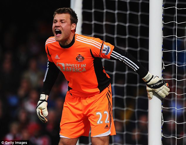 Safe hands: Liverpool want to push through deal for Simon Mignolet