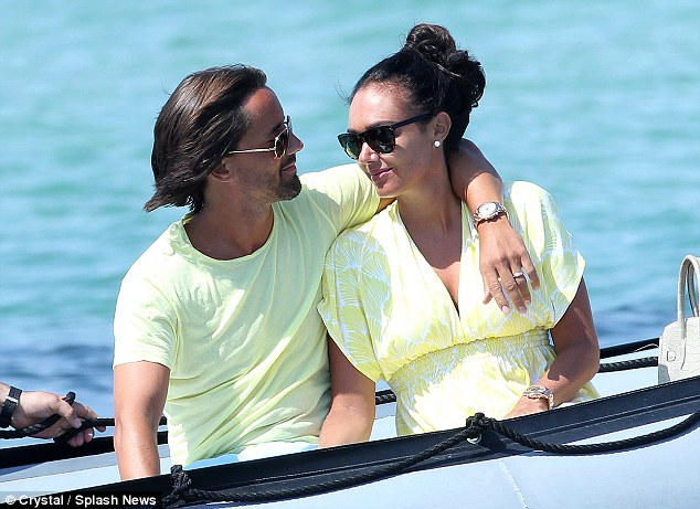 Happy couple: The couple looked utterly loved up as they made their way from their lavish yacht to the shore, with Jay wrapping his arm tenderly around the Formula One heiress