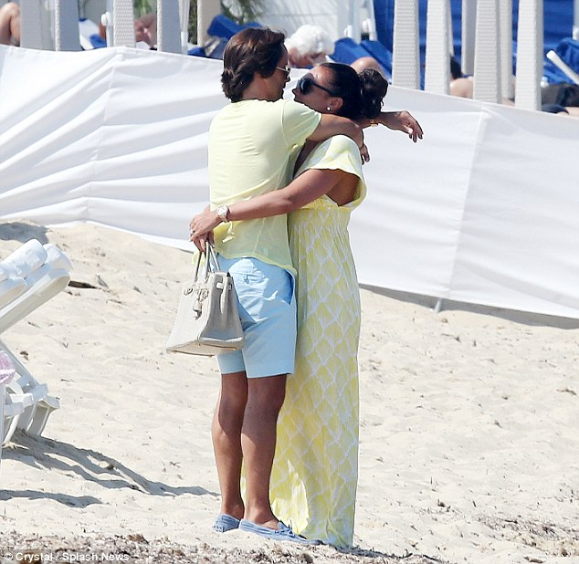 Newlywed bliss: The PDA fest continued as soon as the pair got onto dry land, with the duo stopping for a very amorous kiss on the before heading off to their luncheon destination