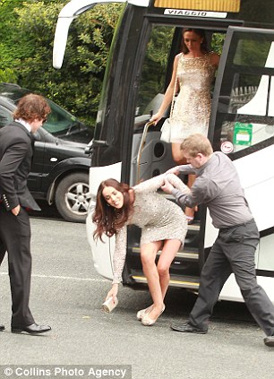 Watch your step: Stephen Hunt's girlfriend almost fell off the bus (left) as Kevin Doyle arrives for the afternoon