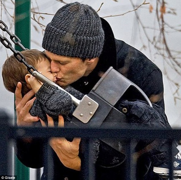 Good catch: Gisele Bundchen posted an image of quarterback Tom Brady with their son Benji