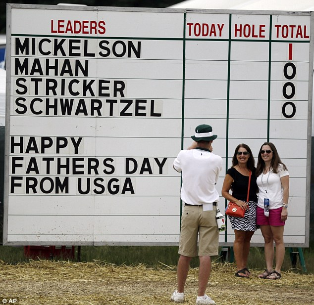 Happy Father's Day! Spectators pose for a photo before the start of the fourth round at Merion