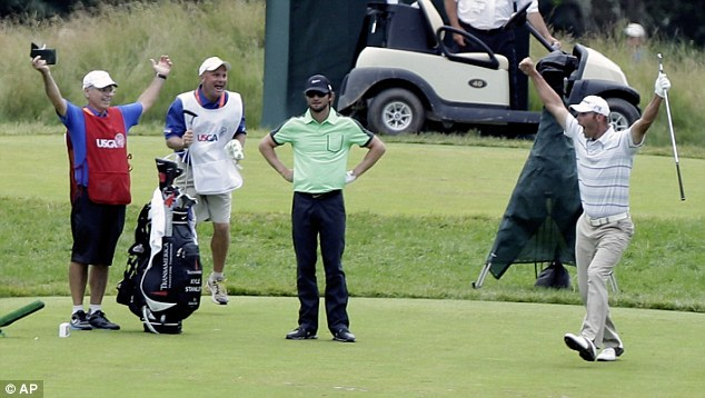 Shawn Stefani (right) reacts after hitting a hole in one on the 17th hole as Kyle Stanley (centre) looks on