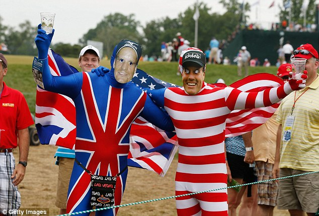 Support: Two fans wear costumes and cut-out faces of Luke Donald of England and Phil Mickelson