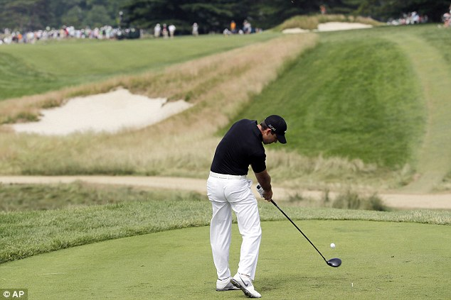 Kids, copy this swing: Charl Schwartzel of South Africa tees off on the fourth hole as he looks for a second major