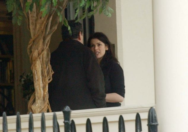 Tension: Miss Lawson looked angry as she spoke to Mr Saatchi at their home in Eaton Square a few years ago