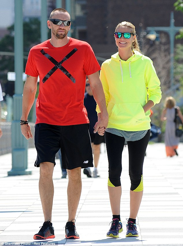 Colour coordinated: The stylish duo were dressed in complimentary workout gear - Heidi in neon yellow, Martin in bright red