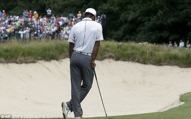 Off his game: Woods appeared to be disappointed with his performance on the course in Pennsylvania