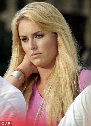 Golf WAG: Vonn, an Olympic skier, made sure she had a Red Bull sponsor's hat firmly on her head during a more casual appearance at a tournament