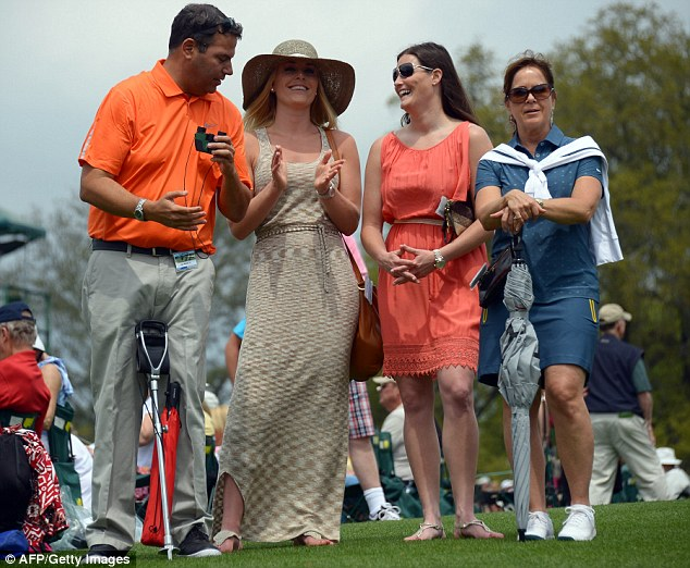 Glamor on the green: Ms Vonn (second left) watches Woods during the Masters in Augusta, Georgia in April