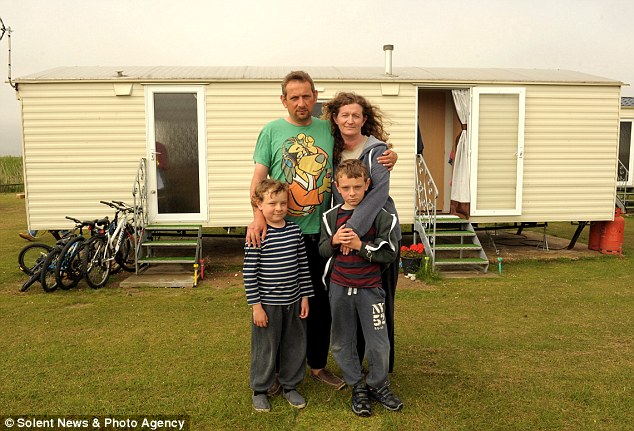 Anger: Luis Goncalves (front left) and his family have been forced to live in this caravan in Selsey, Hampshire, because the tenant is refusing to move out. His father Ed (back left) donated the kidney. Also pictured is mother Siobham and Luis' twin Joe