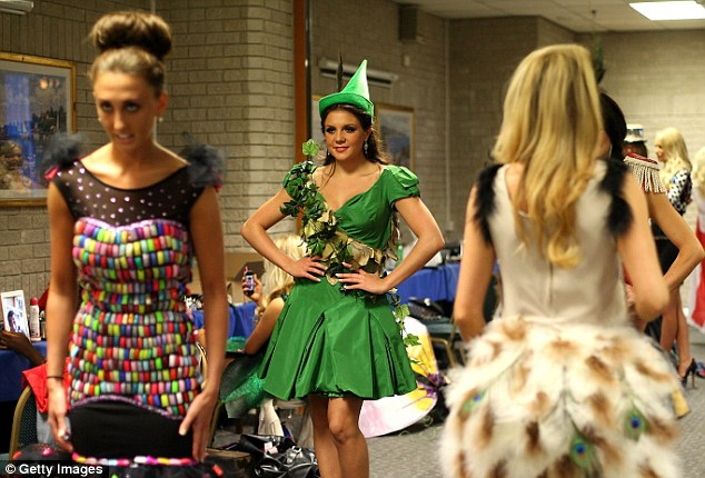 Finalists in outlandish creations prepare backstage before hitting the eco fashion runway