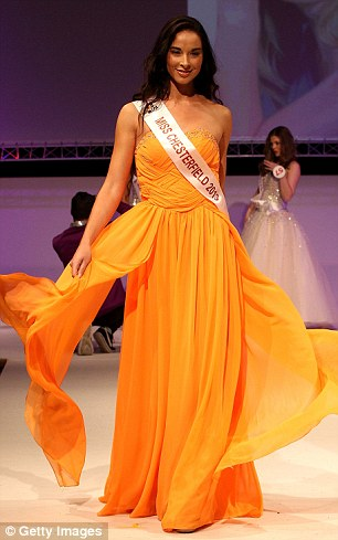 Easy, breezy: Melanie Kollatou, from Chesterfield, shows off a beautiful mango-coloured dress at the final
