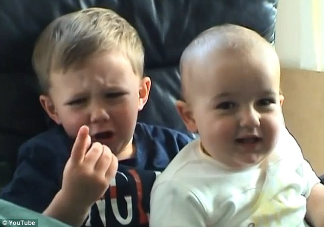No problems: Innocent videos on YouTube, such as the famous 'Charlie bit my finger - again' from 2007, would most likely be given a green (Universal or Parental Guidance) rating by the person uploading them