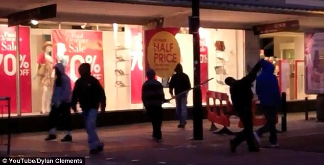 Protecting children: Videos such as this one filmed during the London riots of 2011 may be subject to an 'amber' rating because they could be distressing for younger viewers