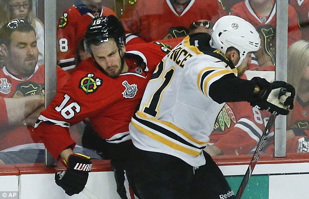 Contrast: Commercials were shown during the breaks between Chicago Blackhawks and the Boston Bruins