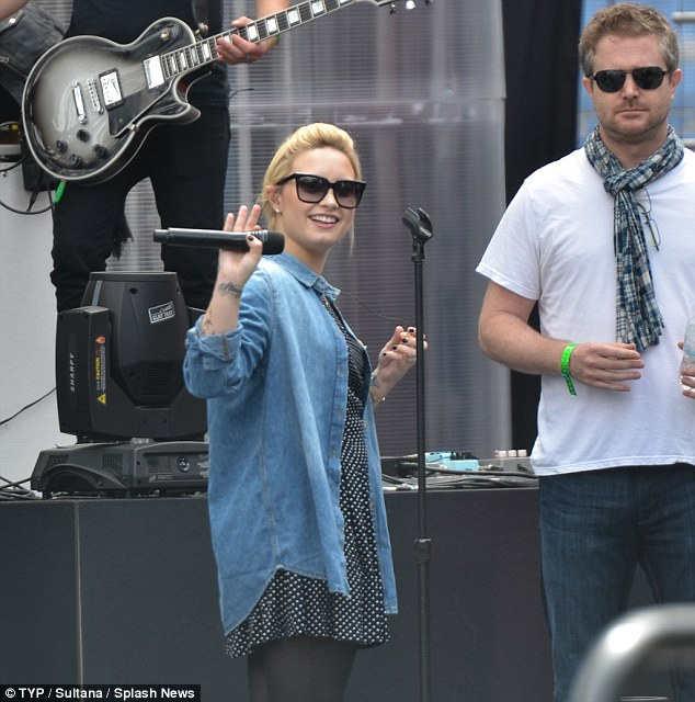 Happy to be there: The star was radiant as she waved to shutterbugs and fans during sound check