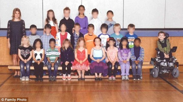 Left out: Miles Ambridge, far right, and the rest of his Grade 2 class at Herbert Spencer Elementary in New Westminster, B.C., during their class photo