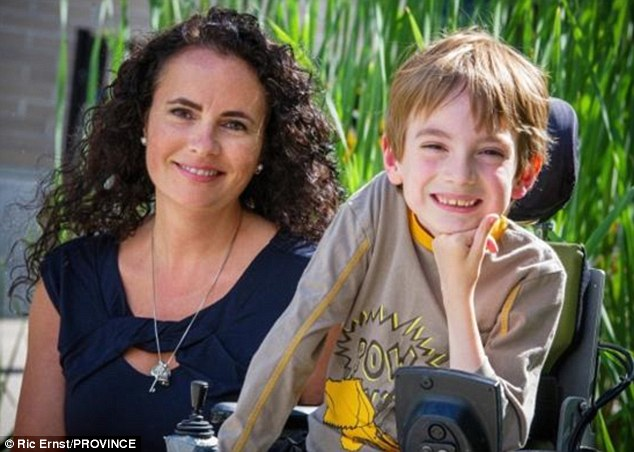 Fighting discrimination: Miles Ambridge and him mom Anne who was left perplexed by the school photographers decision to leave her son out to the side of the class photo