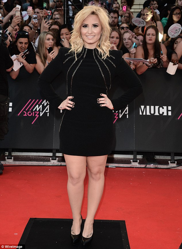 Striking! Demi Lovato arrived on Sunday at the Much Music Video Awards in Toronto, Canada, taking the red carpet by storm in a stunning black dress