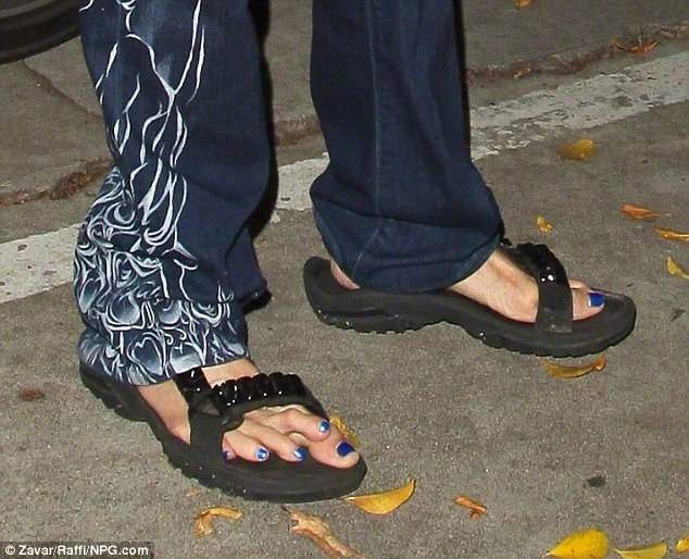 G'ah! The 65-year-old rocker's long appendages stuck out over his black action sandals and were adorned with a royal blue pedicure