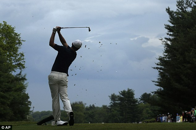 Squeaky bum time: Justin Rose tees off on the 16th hole