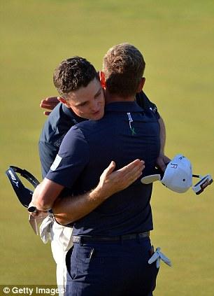 Rose hugs playing partner Luke Donald