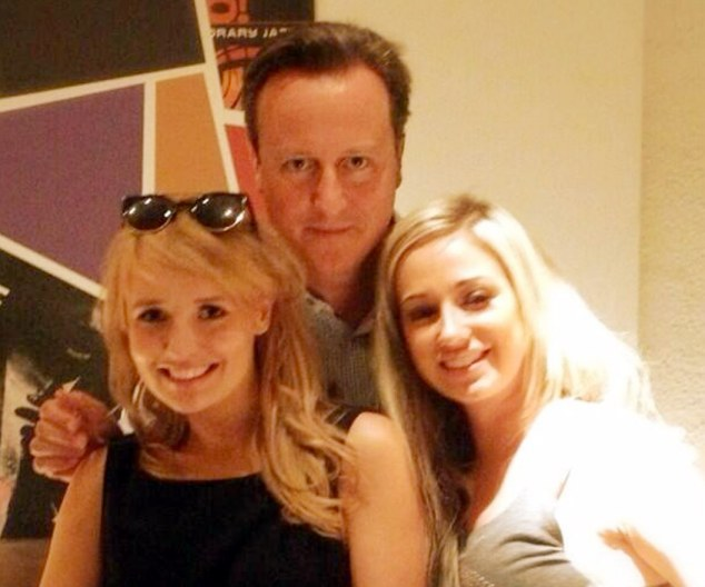 Some cheese with that? David Cameron poses with fellow diners at Pizza Express in Soho during one of his regular 'date nights' with wife Sam
