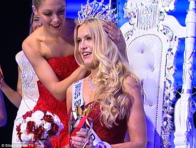 Enthroned: The former Miss North London being crowned by Charlotte Holmes, Kirsty's predecessor