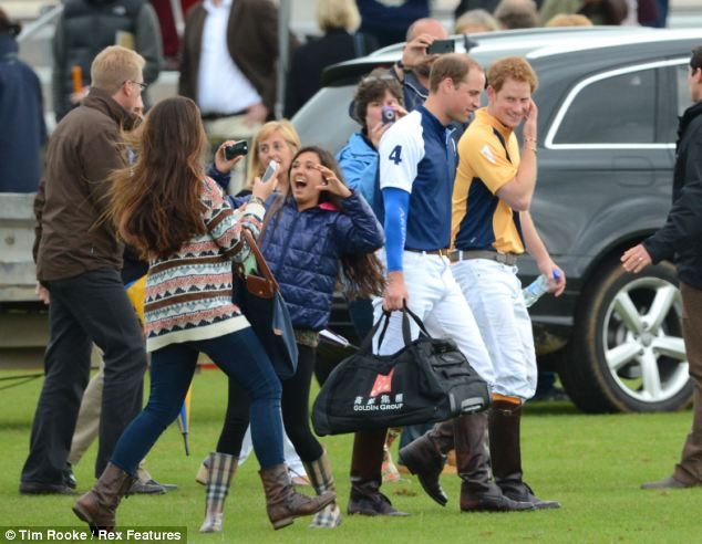 Prince Harry has one last look at the excitable fan as she rejoices with her friends