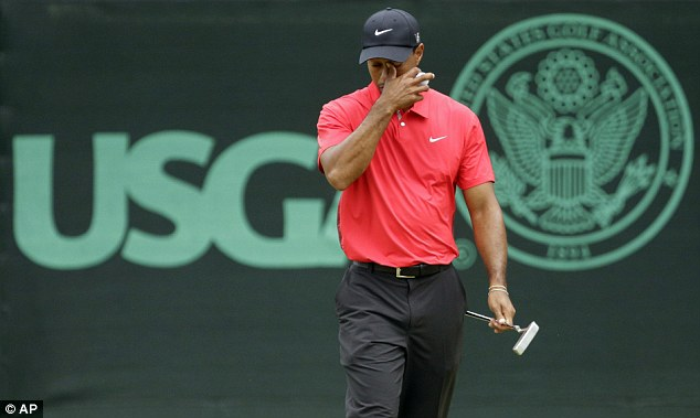 Whoops: Tiger Woods had a bad day at the office as he ran double digits over par
