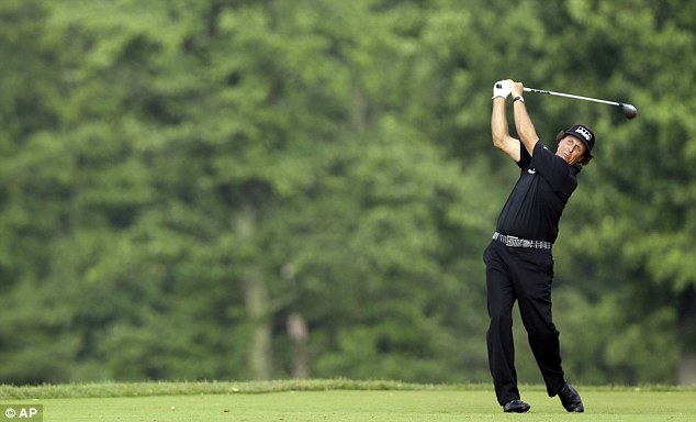 Close run thing: Phil Mickelson was around the top all day and suffered some terrible edges