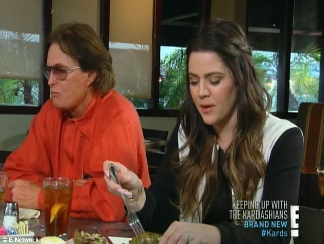 Gun control: Bruce Jenner has a talk with his daughters, including Khloe (right), about wanting to have a gun around the house for protection