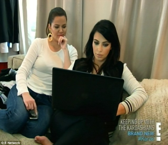 Sister support: Kim confided in Khloe (left) about how her divorce settlement with Kris Humphries keeps dragging on