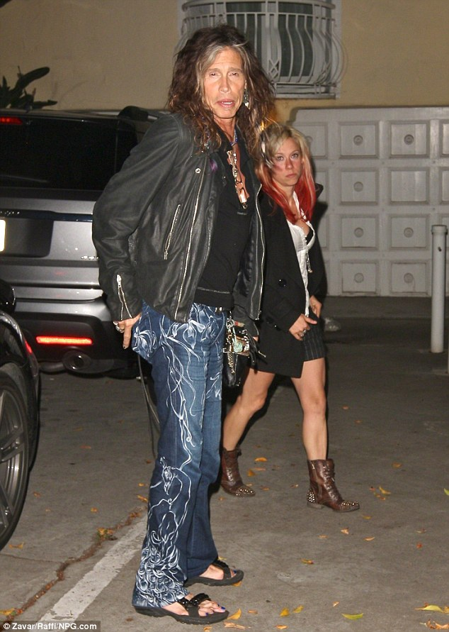Bleary: The Aerosmith frontman accessorised his painted piggies with garish white-streaked jeans and a black leather jacket