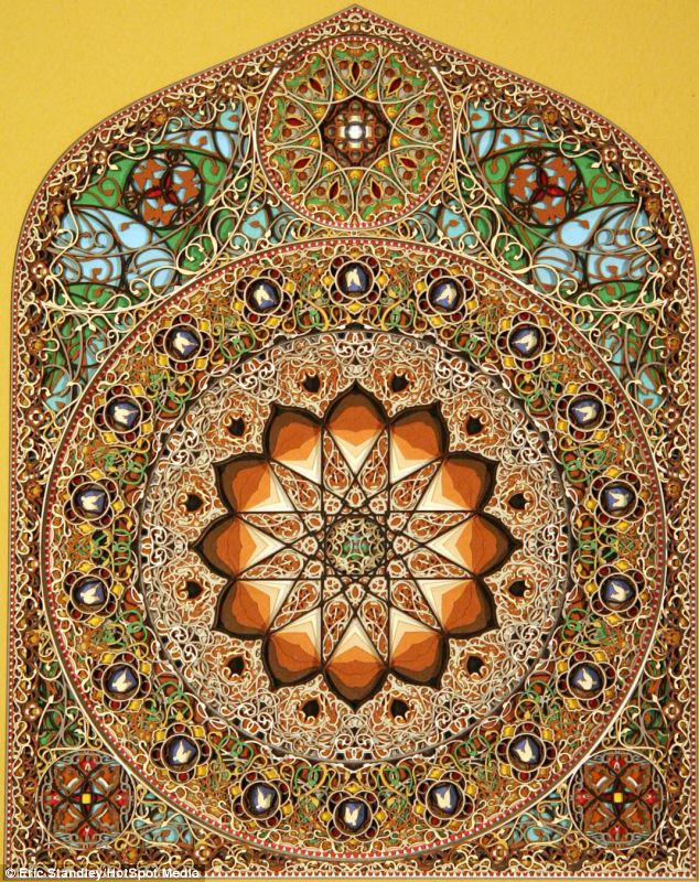 It's not a stained glass window, but hundreds of pieces of paper cut and layered by artist Eric Standley