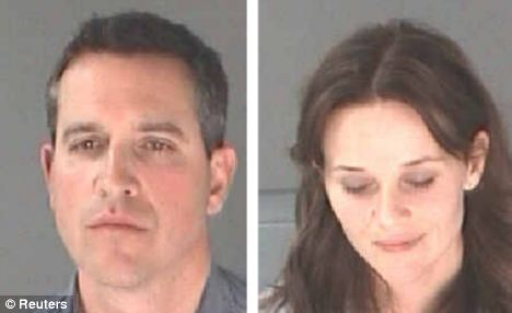 Reese Witherspoon and her husband James Toth pictured after their arrest for D.U.I. in April