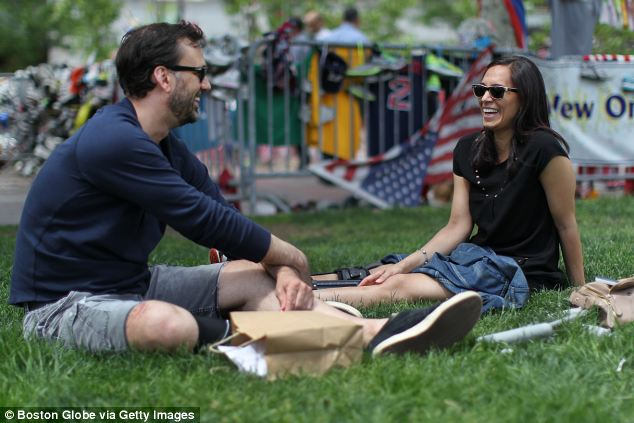 Content: The couple eat lunch in Copley Square by the bombing memorial site