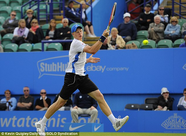 Power surge: Kyle Edmund hits a forehand in his match against Kenny De Schepper