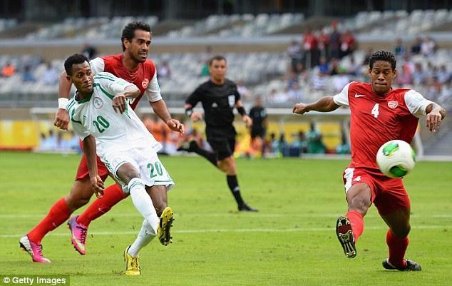 Tucked away: Nnamdi Oduamadi of Nigeria scores his team's second goal