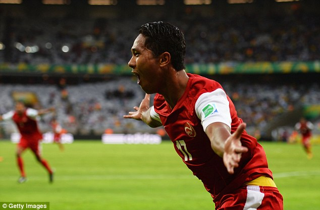 Party time: Even though they were losing, Tahiti celebrated their goal wildly