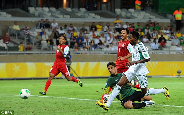 Five star: Oduamadi scores the fifth goal for his country as Tahiti collapsed