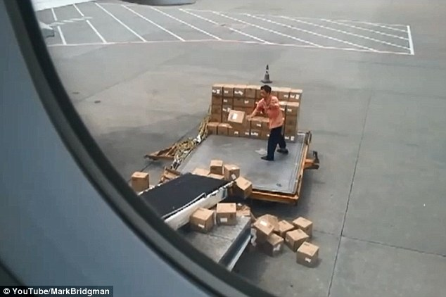 Crash: A hilarious video has captured the care - or distinct lack there of - taken by air freight handlers at Guangzhou airport in China