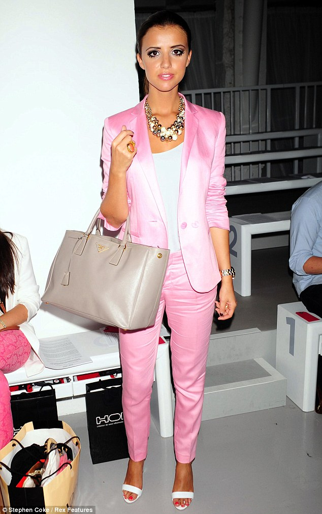 Pink power: Lucy Mecklenburgh looked extremely slender as she attended the HOM by Jonathan Saunders fashion show dressed like a Miami Vice extra