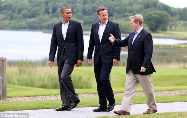 Scenery: The lake has provided the backdrop for many of the photo opportunities of the summit, including this snapshot of US President Barack Obama and Mr  Cameron, walking with Ireland's Taoiseach Enda Kenny