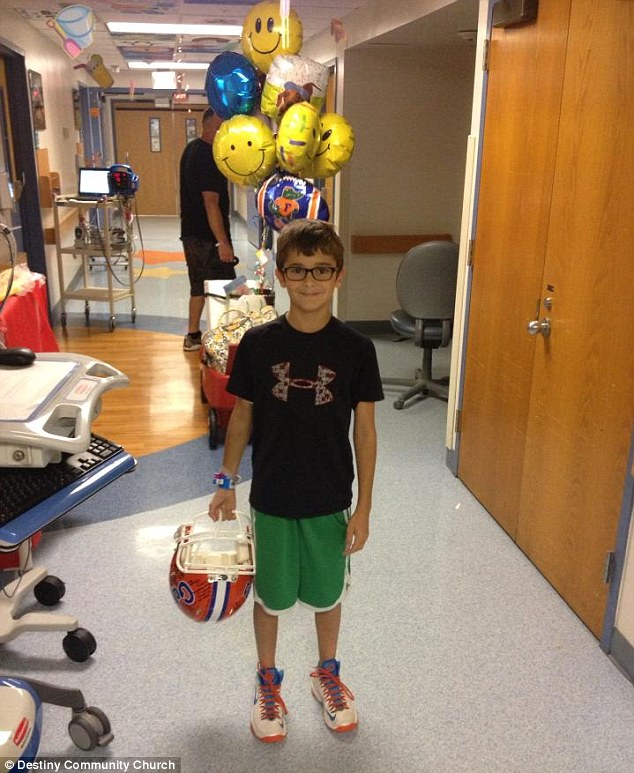 Snakebite victim Benjamin Smith, 11, left hospital with a basketball autographed by members of the University of Florida men's basketball team and other gifts