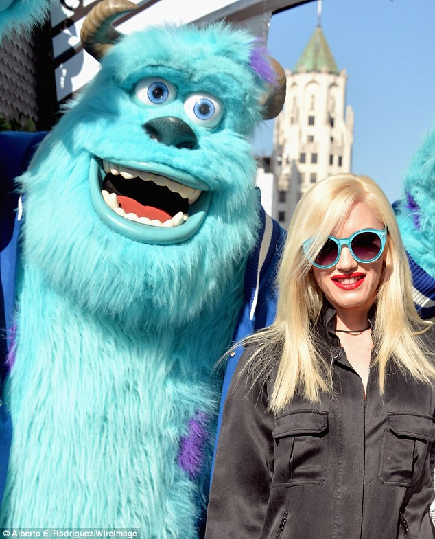 Colour coordinated: Gwen's turquoise sunglasses matched monster Scully's fur