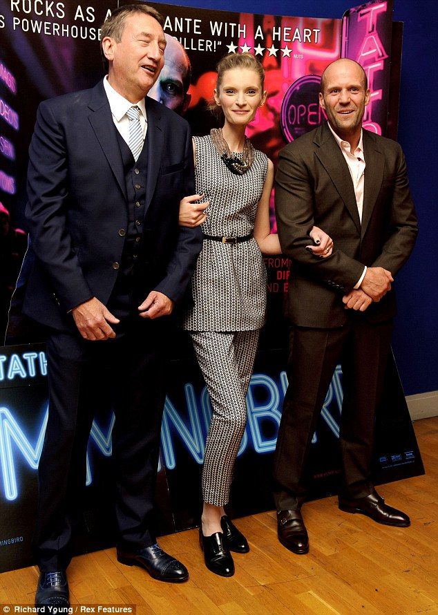 Posing up: Agata posed alongside co-star Jason Statham and the movie's director Steven Knight at the premiere
