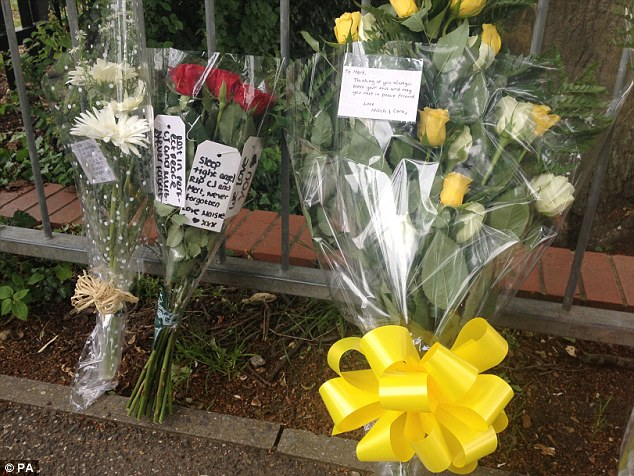 Floral tributes: More flowers which were left outside the gates of Hertswood Academy. The teenagers' headteacher described them as 'talented, hard-working and well-respected'