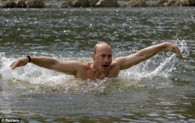 Action man: Swimming in lakes has previously been seen as the recreation of choice for Russian President Vladimir Putin, pictured taking a dip in 2009